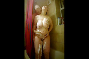 Mature couple in the shower. Big tits..