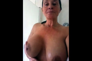 Busty granny taking a shower. Looks..