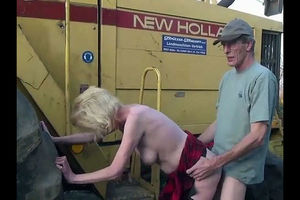 Grind granny pounded by tractor-driver..