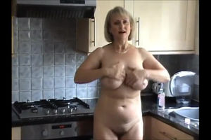 Busty mature takes off all nylons to..