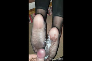 Messy cum load on mature feet in nylon