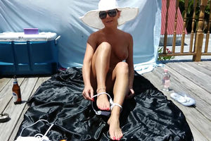 Enormous tits MILF sunbathing without..