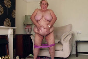 Highly fat woman trying milking